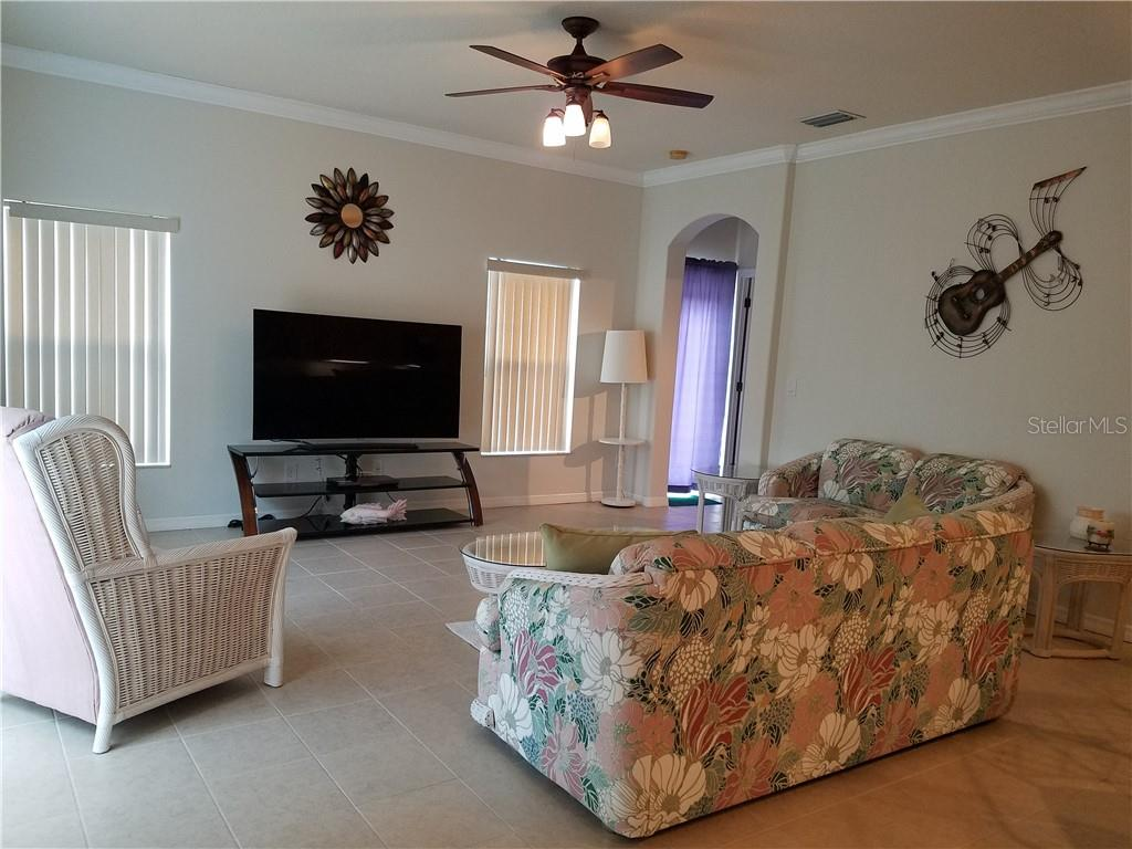 The family room/great room is open and bright. - Single Family Home for sale at 2752 Suncoast Lakes Blvd, Punta Gorda, FL 33980 - MLS Number is C7402671