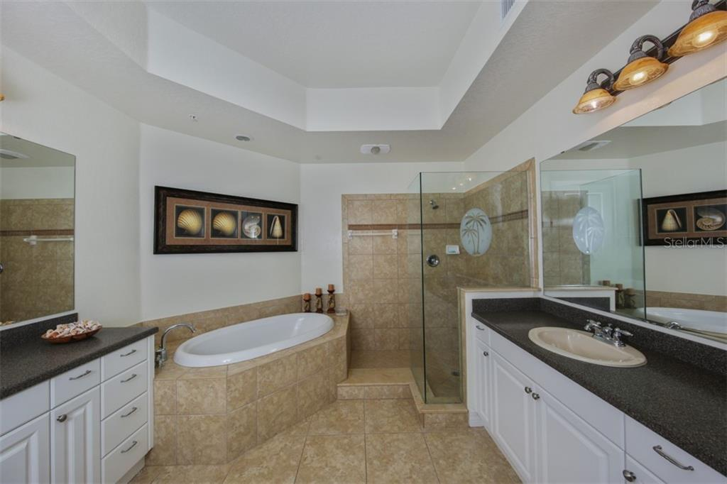 Spa-like master bathroom with dual vanity sinks, garden tub, and walk-in shower - Condo for sale at 95 Vivante Blvd #303, Punta Gorda, FL 33950 - MLS Number is C7402746