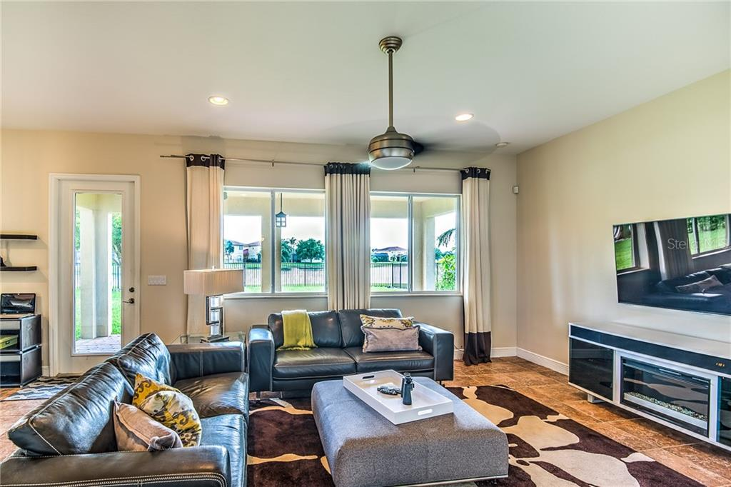 Cozy Family Room with plenty of light and a view of the lake - Single Family Home for sale at 24123 Riverfront Dr, Port Charlotte, FL 33980 - MLS Number is C7402813