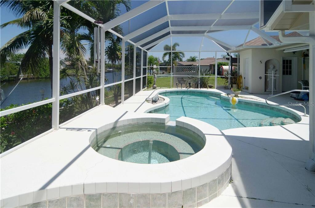 Large spa and pool.  This is the Florida lifestyle. - Single Family Home for sale at 9199 Key West St, Port Charlotte, FL 33981 - MLS Number is C7403206