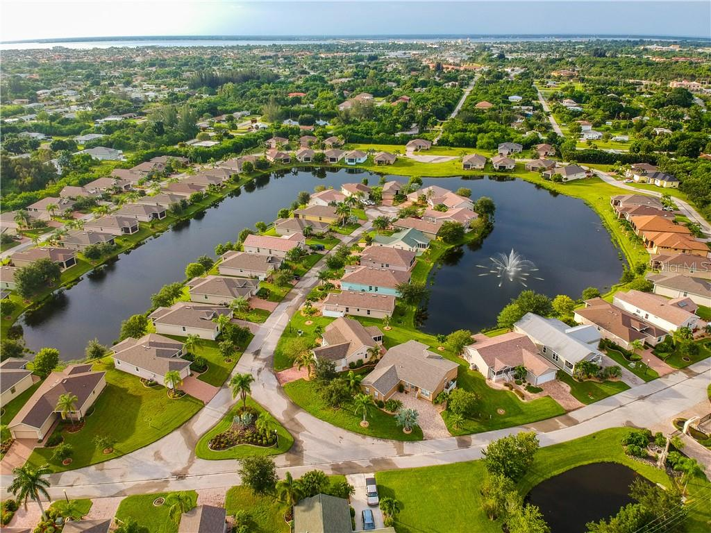 Aerial view of Rio Villa Lakes community - Single Family Home for sale at 8663 Lake Front Ct, Punta Gorda, FL 33950 - MLS Number is C7403960