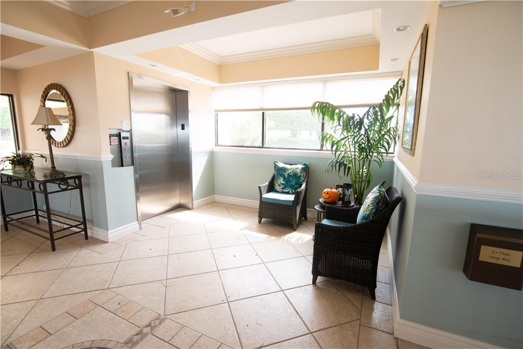 The main lobby/reception area is newly decorated and painted.  The secured lobby is accessible only by limited-issued keys. - Condo for sale at 1601 Park Beach Cir #112 / 2, Punta Gorda, FL 33950 - MLS Number is C7407435