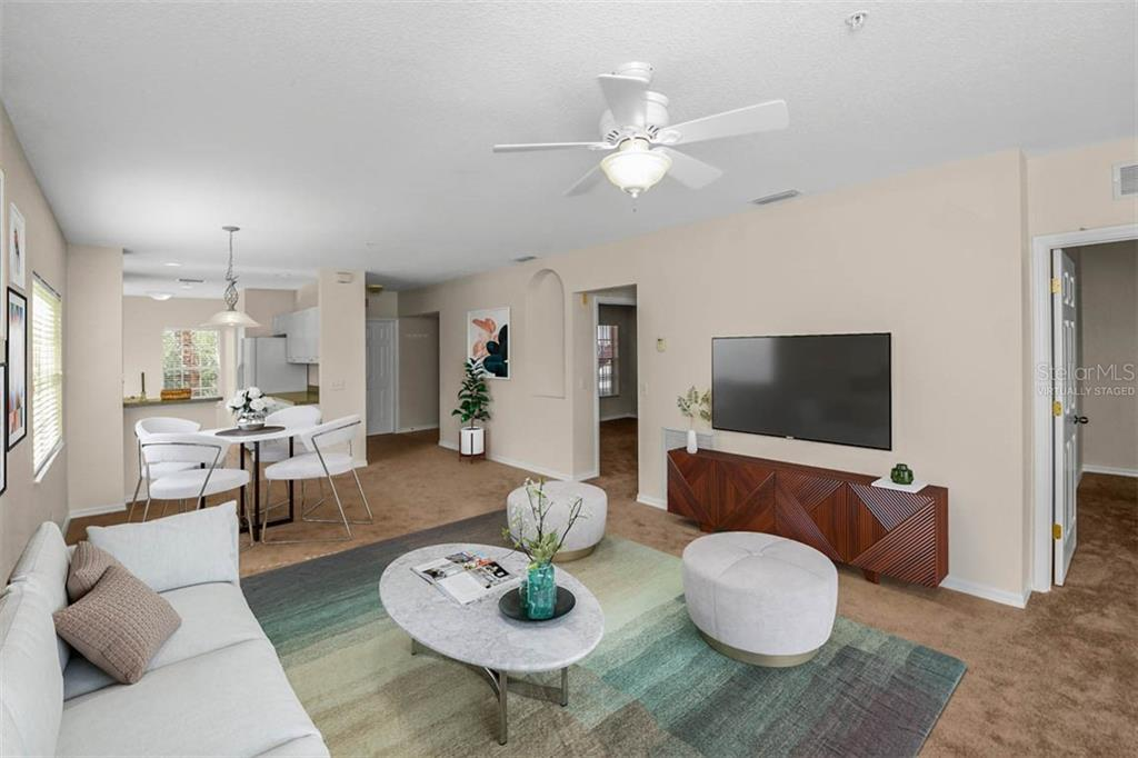 Virtually staged Great Room looking towards front & entry foyer. - Condo for sale at 2040 Willow Hammock Cir #b208, Punta Gorda, FL 33983 - MLS Number is C7408424