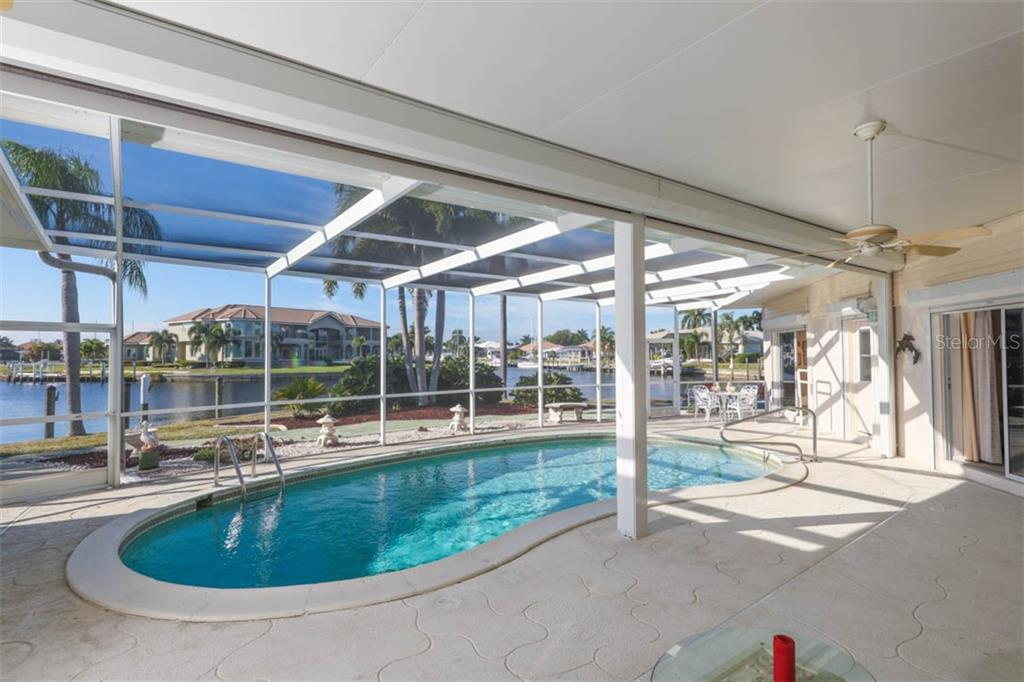 Pool to water from Lanai. Motorized screen plus electric roll down protection. - Single Family Home for sale at 2291 Bayview Rd, Punta Gorda, FL 33950 - MLS Number is C7409445