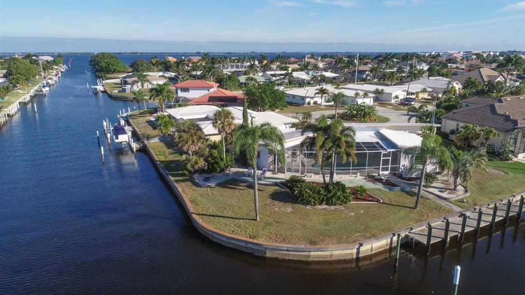 Large concrete dock & still plenty of waterfront footage & back yard - Single Family Home for sale at 2291 Bayview Rd, Punta Gorda, FL 33950 - MLS Number is C7409445