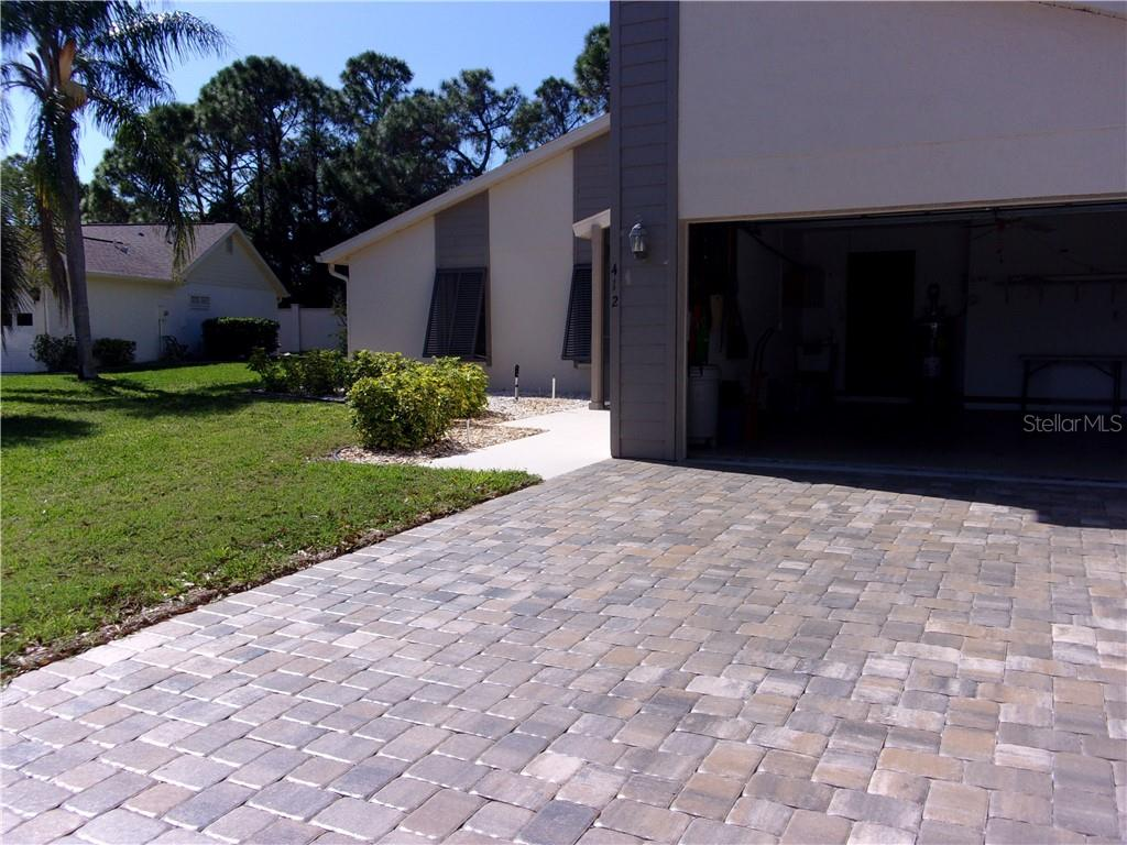 Single Family Home for sale at 412 Cypress Forest Dr, Englewood, FL 34223 - MLS Number is C7411478