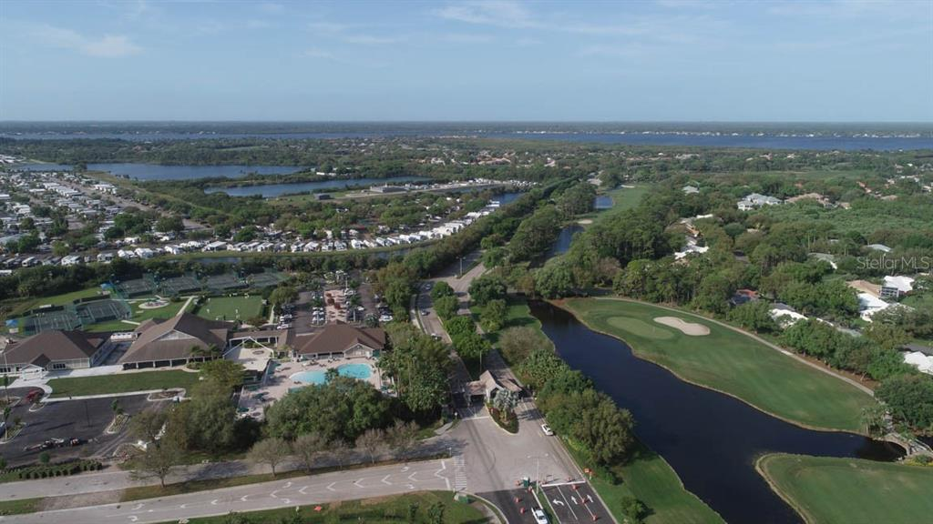 Aerial of clubhouse and golf course in Riverwood - Condo for sale at 4643 Club Dr #102, Port Charlotte, FL 33953 - MLS Number is C7413207
