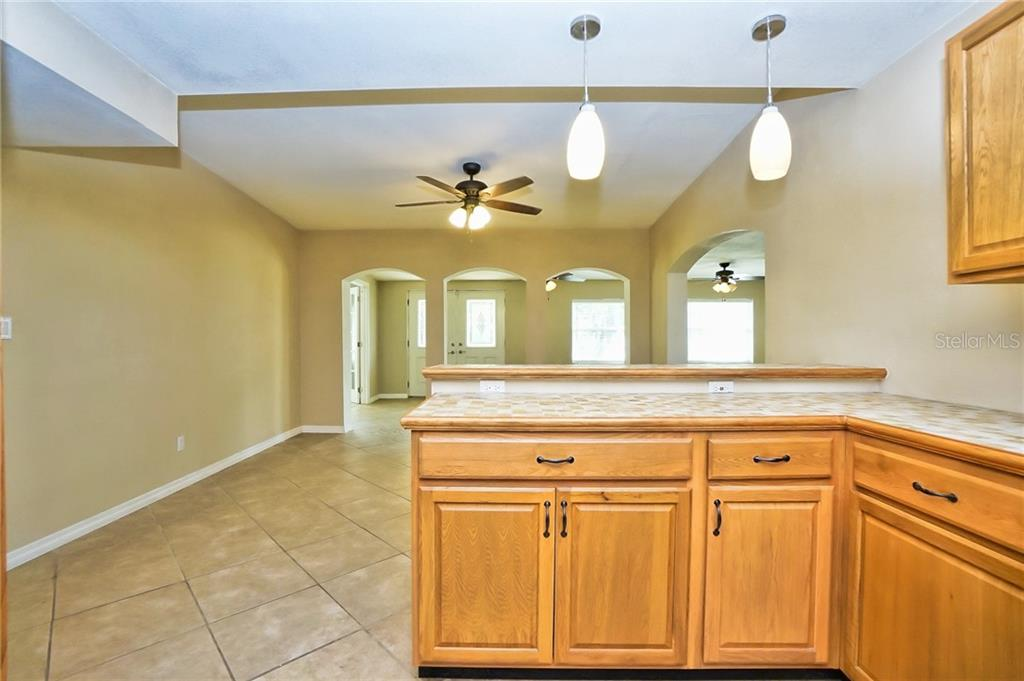 View from Kitchen of Breakfast Bar - Pendant Lights - Single Family Home for sale at 3513 Areca St, Punta Gorda, FL 33950 - MLS Number is C7414620