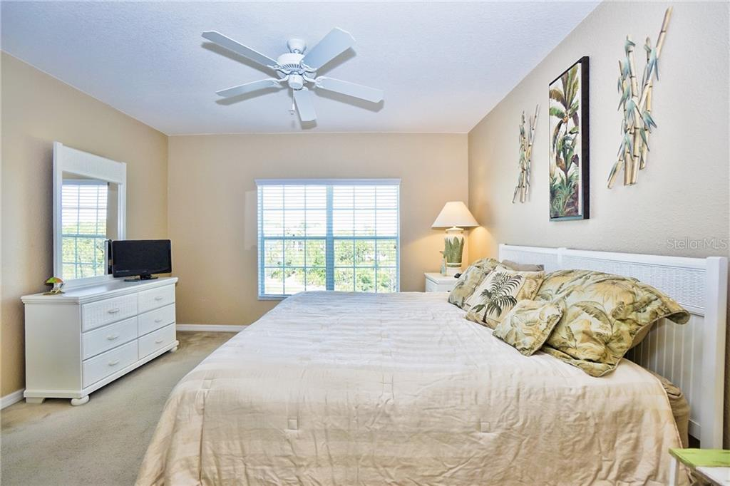 Another master bedroom view looking out back of complex - Condo for sale at 8405 Placida Rd #401, Placida, FL 33946 - MLS Number is C7414726