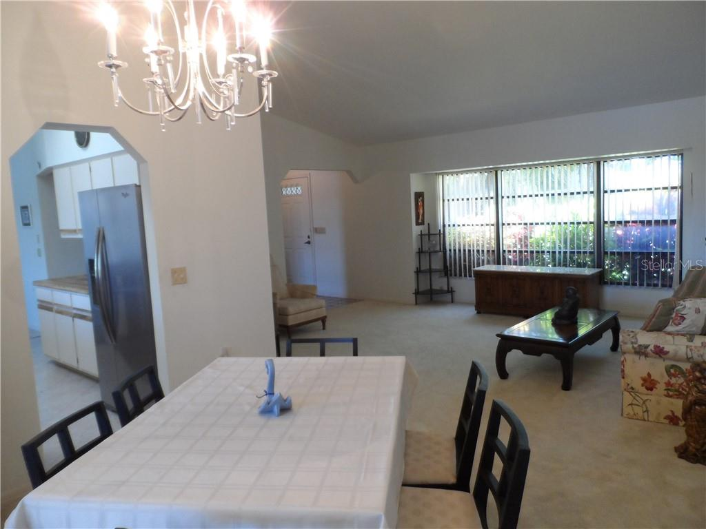 Dining room toward Kitchen and Living room - Single Family Home for sale at 24126 Santa Inez Rd, Punta Gorda, FL 33955 - MLS Number is C7416081