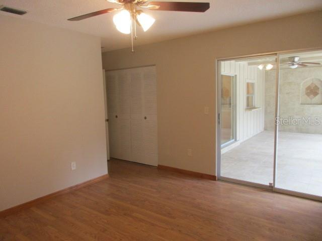 MASTER SUITE THERE IS A 2ND CLOSET  DIRECT OPPOSITE WALL FROM THE ONE SHOWN, SLIDERS TO YOUR BEAUTIFUL LANAI - Single Family Home for sale at 925 Tropical Ave Nw, Port Charlotte, FL 33948 - MLS Number is C7417107