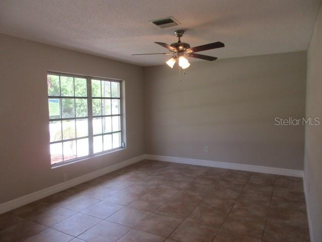 ANOTHER VIEW OF LIVING ROOM FROM DINING AREA - Single Family Home for sale at 925 Tropical Ave Nw, Port Charlotte, FL 33948 - MLS Number is C7417107
