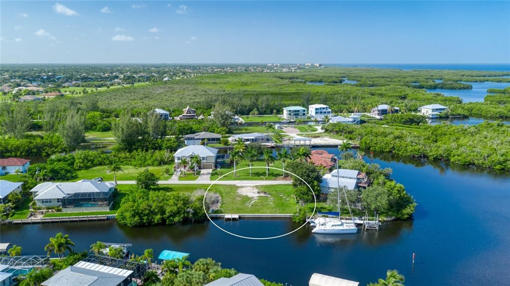 Pirate Harbor has beautiful new homes - this lot is surrounded by newer homes - Vacant Land for sale at 24166 Henry Morgan Blvd, Punta Gorda, FL 33955 - MLS Number is C7417999