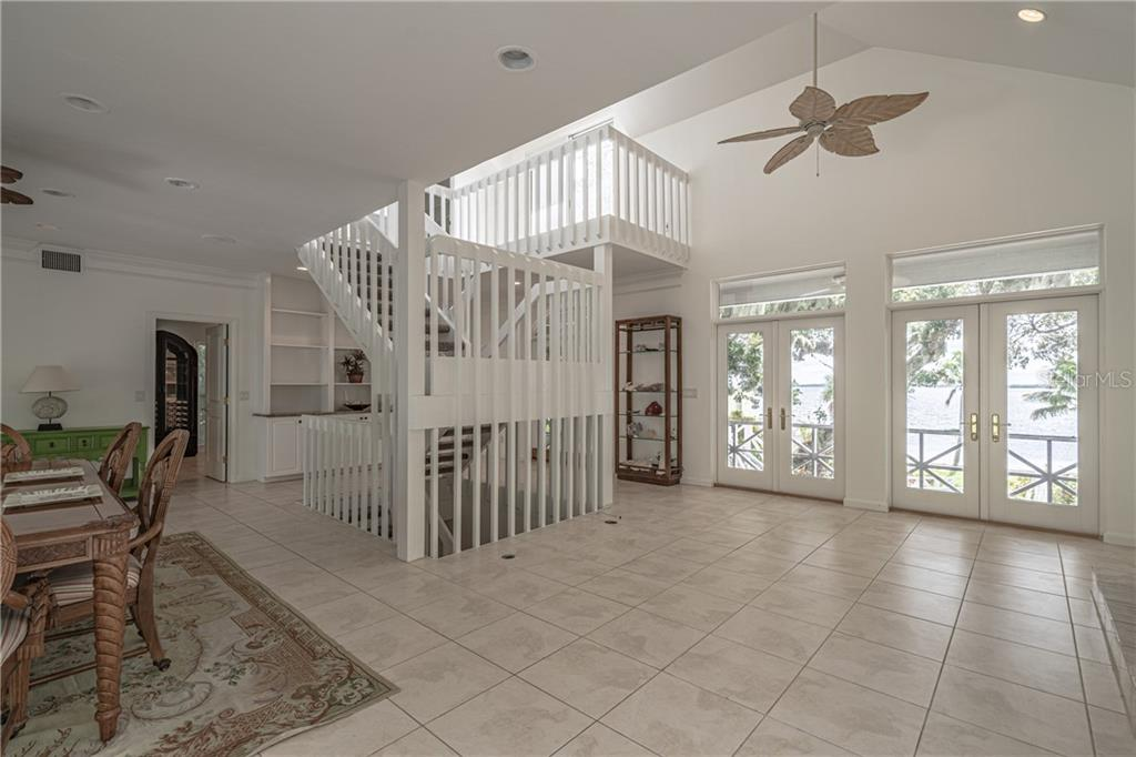 The great room~ fireplace, doors out to the front and back porches - Single Family Home for sale at 124 Useppa Is, Captiva, FL 33924 - MLS Number is C7419408