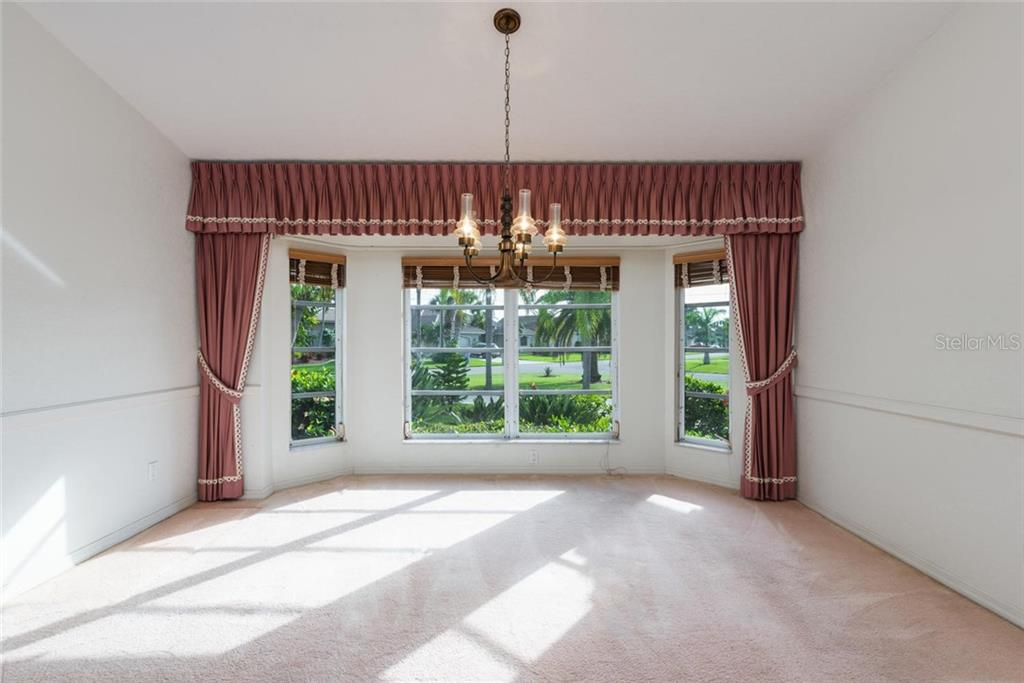 Dining room opens to beautifully landscaped yard - Single Family Home for sale at 5001 Captiva Ct, Punta Gorda, FL 33950 - MLS Number is C7422558