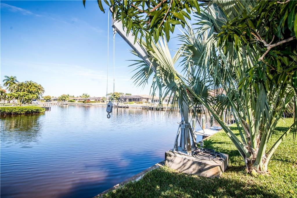 Operating davits in place. A boat lift can easily be added to dock, accomodating a large boat. - Single Family Home for sale at 1440 Appian Dr, Punta Gorda, FL 33950 - MLS Number is C7425399