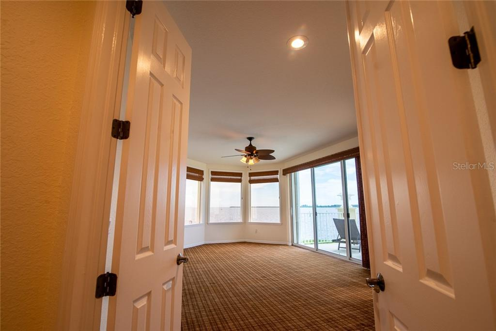 A double-door entry welcomes you to your owner's suite, large and spacious, it also features a private balcony, walk-in closet and ensuite bath. - Condo for sale at 4410 Warren Ave #511, Port Charlotte, FL 33953 - MLS Number is C7432222