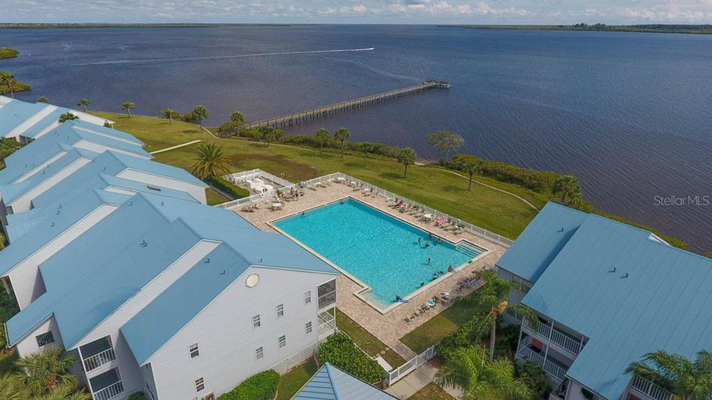 This small community features an Olympic-sized heated pool and a private fishing pier for residents. - Condo for sale at 4410 Warren Ave #511, Port Charlotte, FL 33953 - MLS Number is C7432222