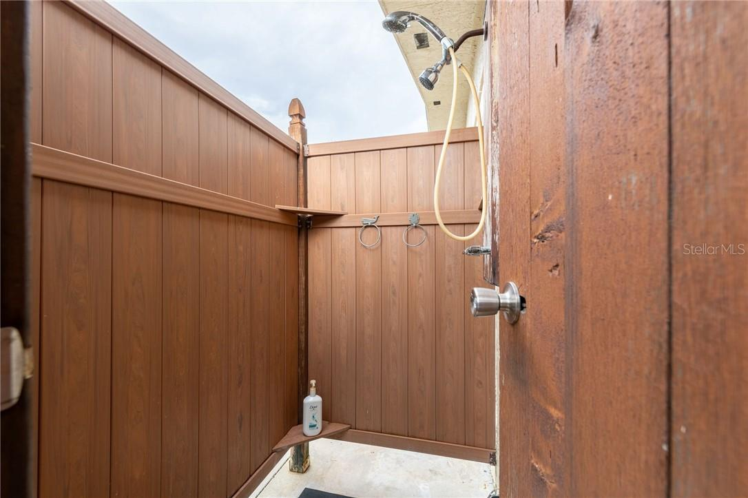 Outside shower for after boating, fishing clean up. - Single Family Home for sale at 24368 Blackbeard Blvd, Punta Gorda, FL 33955 - MLS Number is C7436898