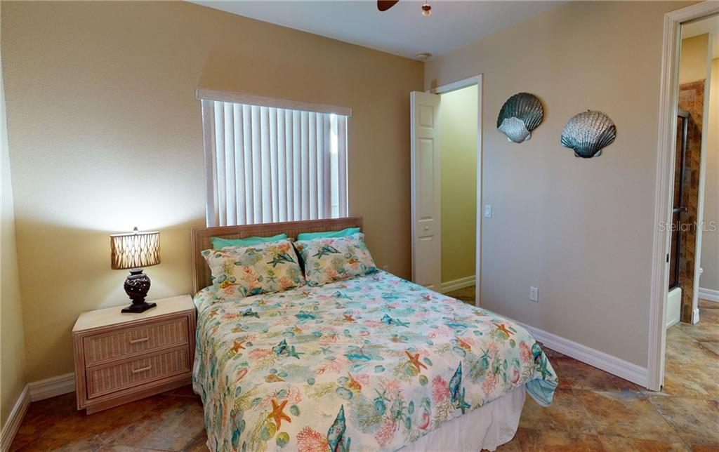 1st floor guest bedroom with walk-in closet. - Single Family Home for sale at 4245 Spire St, Port Charlotte, FL 33981 - MLS Number is C7437570