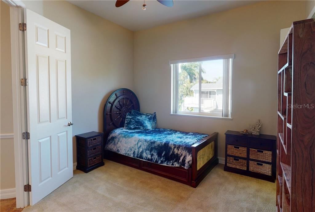 2nd floor guest bedroom. - Single Family Home for sale at 4245 Spire St, Port Charlotte, FL 33981 - MLS Number is C7437570