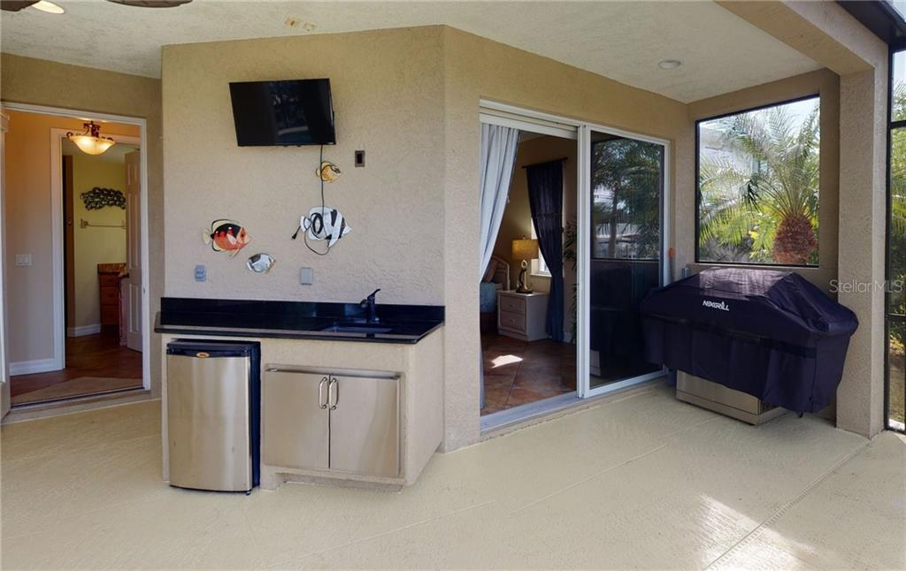 Out door kitchen. - Single Family Home for sale at 4245 Spire St, Port Charlotte, FL 33981 - MLS Number is C7437570