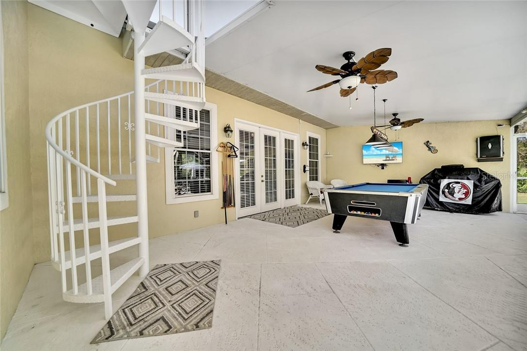Spiral staircase from master bedroom to Lanai - Single Family Home for sale at 10230 Sw County Road 769, Arcadia, FL 34269 - MLS Number is C7437596