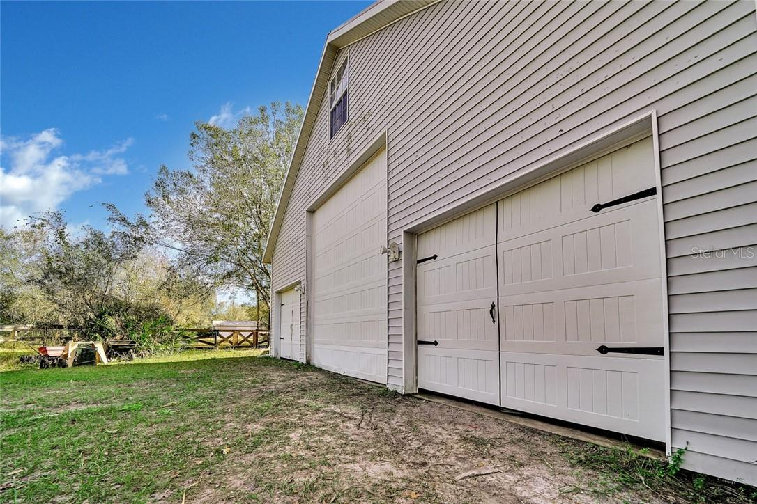 RV garage door with 50 amp plug and dump station - Single Family Home for sale at 10230 Sw County Road 769, Arcadia, FL 34269 - MLS Number is C7437596