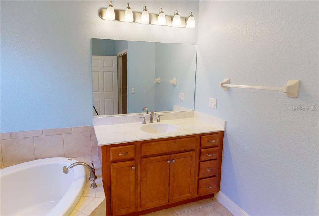 Master bath her vanity. - Single Family Home for sale at 11905 Florence Ave, Port Charlotte, FL 33981 - MLS Number is C7441003