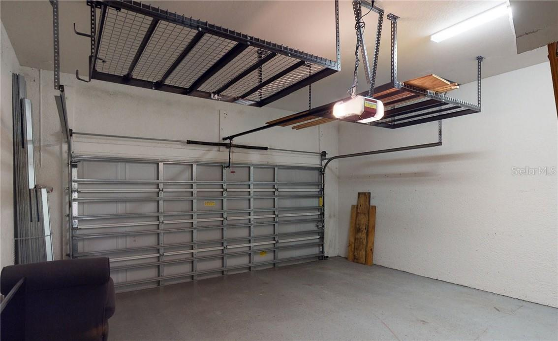 Garage view with extra storage above. - Single Family Home for sale at 11905 Florence Ave, Port Charlotte, FL 33981 - MLS Number is C7441003