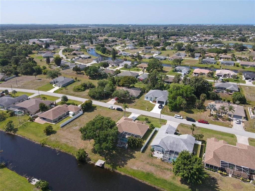 overhead view from rear of home as well as some of community - Single Family Home for sale at 116 Mariner Ln, Rotonda West, FL 33947 - MLS Number is C7441260