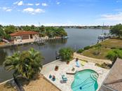 One of the loveliest lots and views in the entire Grassy Point Sailing Community! - Single Family Home for sale at 158 Morgan Ln Se, Port Charlotte, FL 33952 - MLS Number is C7400633