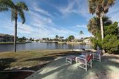 Watch the boats while you wait for spectacular sunsets. - Single Family Home for sale at 2291 Bayview Rd, Punta Gorda, FL 33950 - MLS Number is C7409445