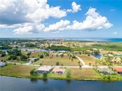 Beautiful view of Burnt Store Lakes Burnt Store Marina and the Charlotte Harbor in the background. - Single Family Home for sale at 24126 Santa Inez Rd, Punta Gorda, FL 33955 - MLS Number is C7416081