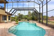 HEATED SALT WATER POOL AND HEATED SPA.  TWO STORY SCREEN ENCLOSURE - Single Family Home for sale at 3700 Como St, Port Charlotte, FL 33948 - MLS Number is C7425275