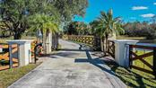 Gated entry with security keypad - Single Family Home for sale at 10230 Sw County Road 769, Arcadia, FL 34269 - MLS Number is C7437596