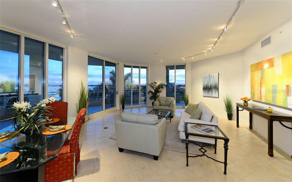 Living/Dining room with sliders to terrace with Sarasota Bay views - Condo for sale at 500 S Palm Ave #41, Sarasota, FL 34236 - MLS Number is A4144835