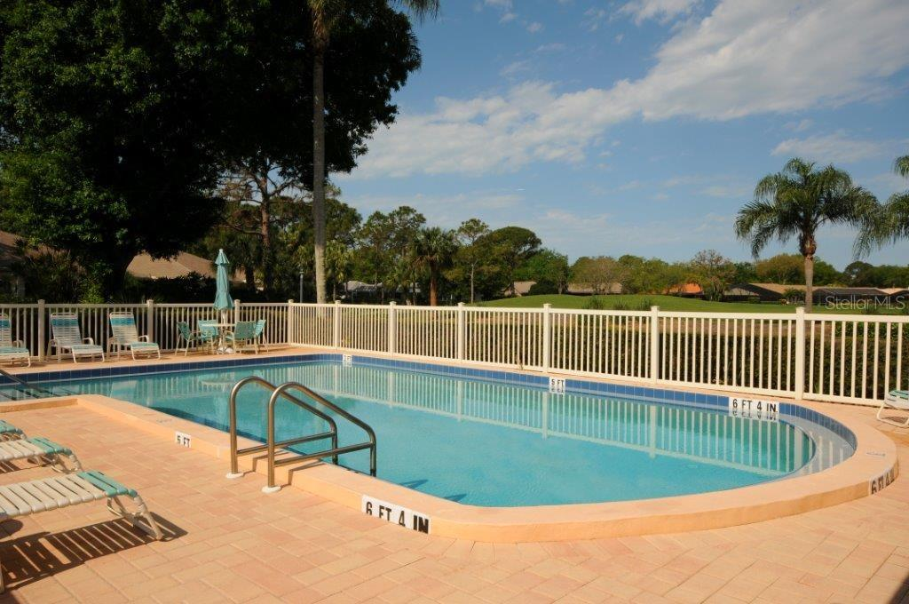 Community swimming pool and sun deck - Villa for sale at 5510 Chanteclaire #46, Sarasota, FL 34235 - MLS Number is A4156527