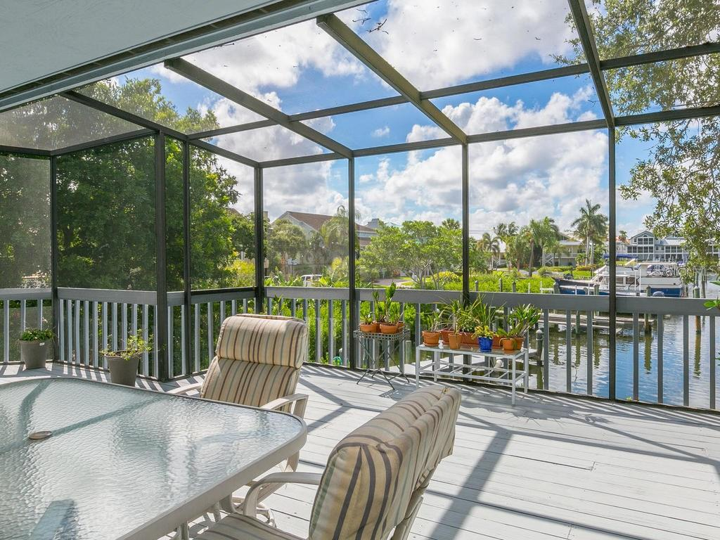 Screened balcony with water views - Single Family Home for sale at 1272 Riegels Landing Dr, Sarasota, FL 34242 - MLS Number is A4160033