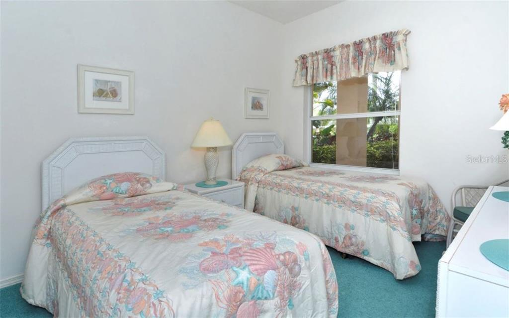 Guest bedroom with quiet corner view. - Condo for sale at 9630 Club South Cir #6103, Sarasota, FL 34238 - MLS Number is A4166105