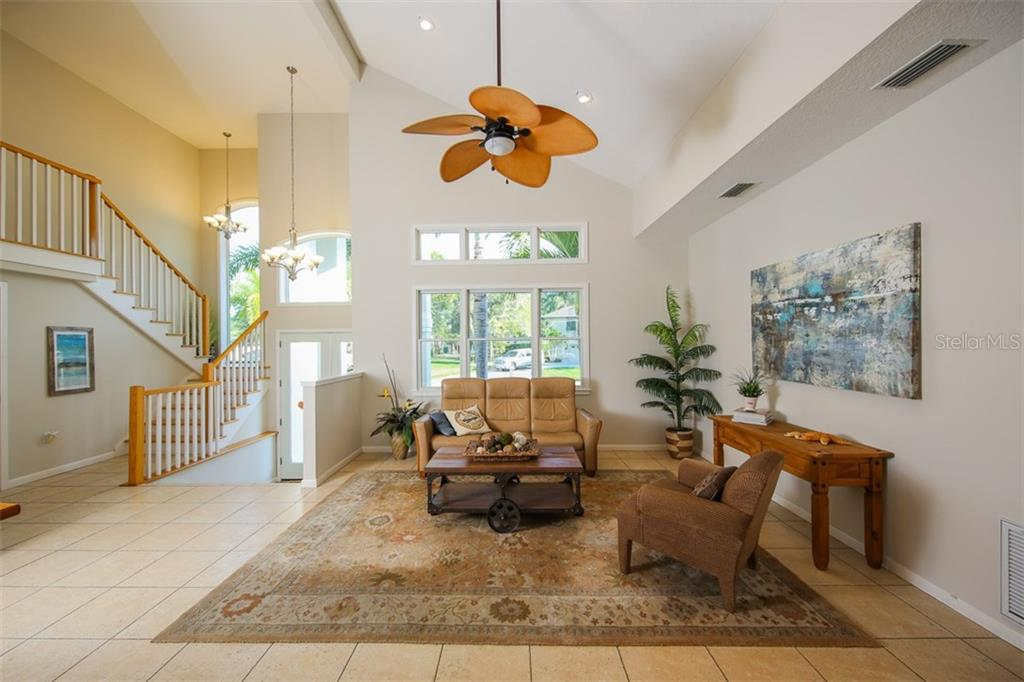 Living room - Single Family Home for sale at 827 Paradise Way, Sarasota, FL 34242 - MLS Number is A4167744