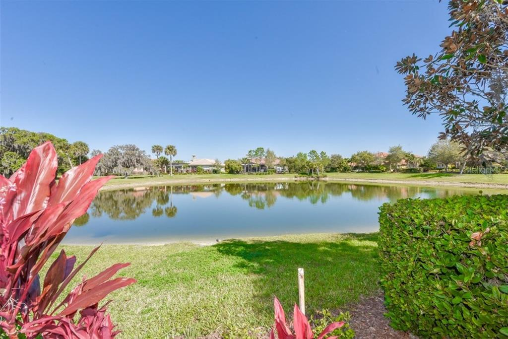 Another beautiful pond affords privacy to the north side of the home. - Single Family Home for sale at 3313 Founders Club Dr, Sarasota, FL 34240 - MLS Number is A4169443