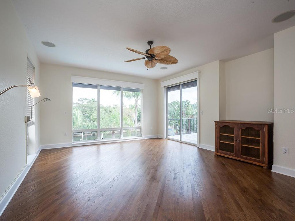 Master bedroom with sliders to balcony - Single Family Home for sale at 4789 Higel Ave, Sarasota, FL 34242 - MLS Number is A4169949