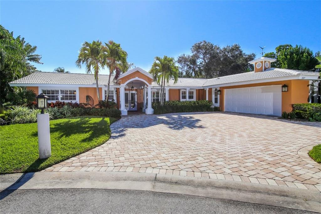 Expansive front view of home, landscaping, and paver driveway. - Single Family Home for sale at 5281 Cape Leyte Way, Sarasota, FL 34242 - MLS Number is A4171478