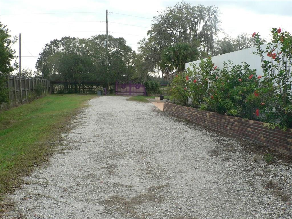 View towards Golf Course Road and Electric Gate - Single Family Home for sale at 16314 Golf Course Rd, Parrish, FL 34219 - MLS Number is A4171555