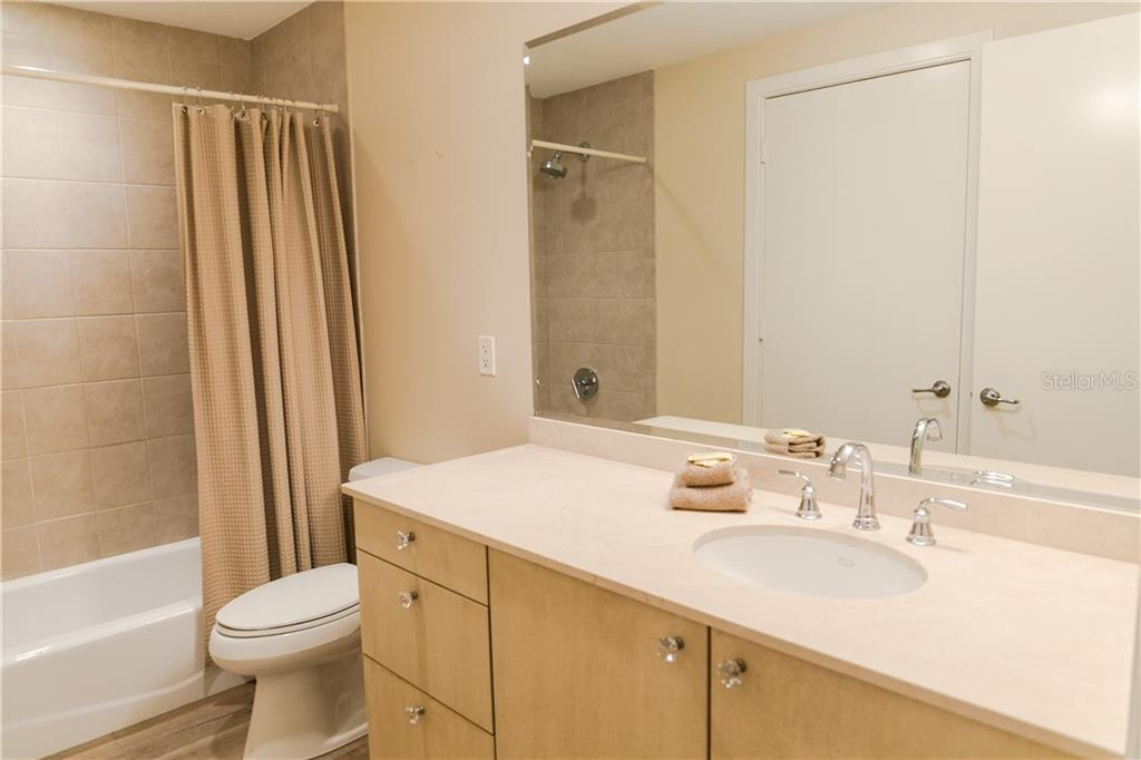 Guest Bath - Condo for sale at 6512 Midnight Pass Rd #406, Sarasota, FL 34242 - MLS Number is A4171720