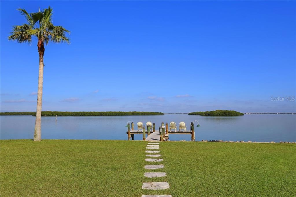 Private Fishing Pier for Residents of Longboat Key Estates! - Single Family Home for sale at 593 Rountree Dr, Longboat Key, FL 34228 - MLS Number is A4172941