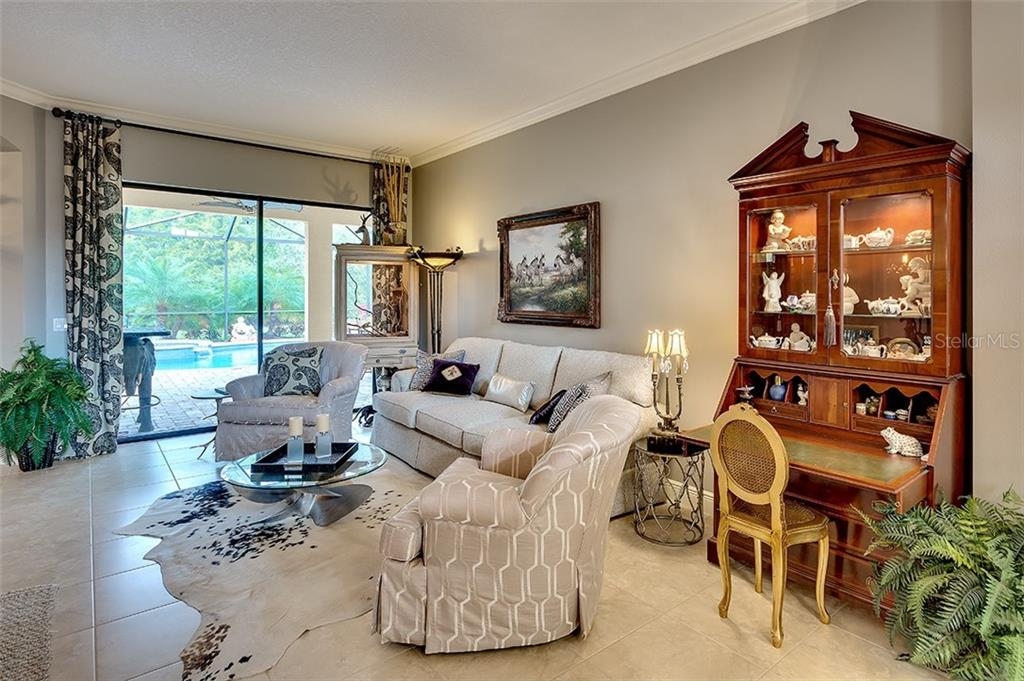 Wonderful view of the pol from the Living and Formal Dining room - Single Family Home for sale at 7254 Lake Forest Gln, Lakewood Ranch, FL 34202 - MLS Number is A4174107