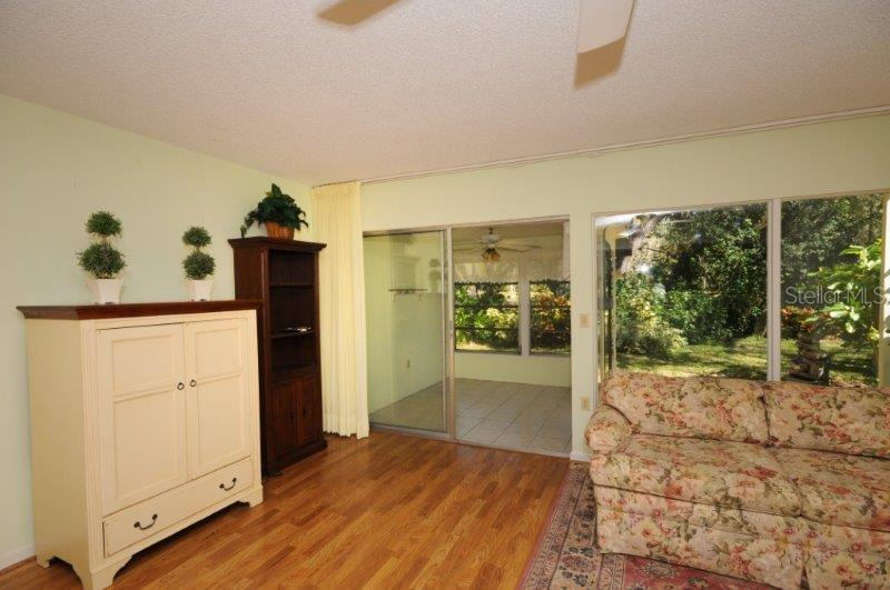 Living room with sliders - Condo for sale at 2215 Circlewood Dr #46, Sarasota, FL 34231 - MLS Number is A4180138