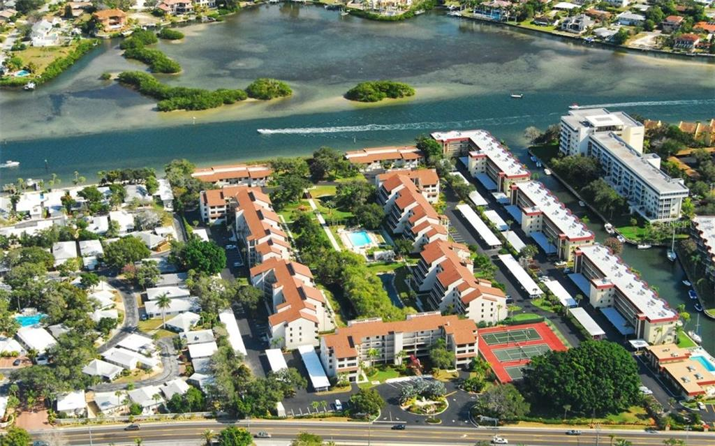Aerial view of Community on Intracoastal - Condo for sale at 6263 Midnight Pass Rd #101, Sarasota, FL 34242 - MLS Number is A4182245